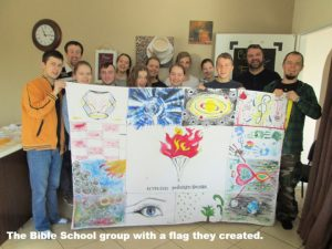 Bible school group with a flag they created