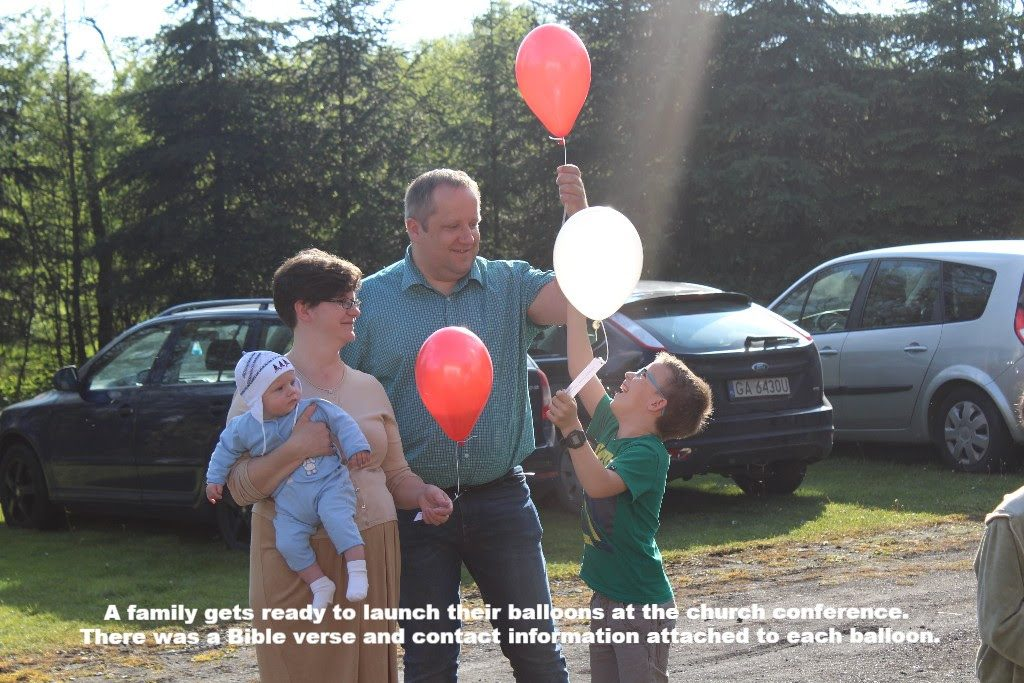A family prepares to launch balloons during the church conference