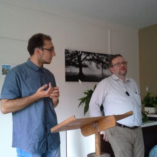 Peter translating during a service