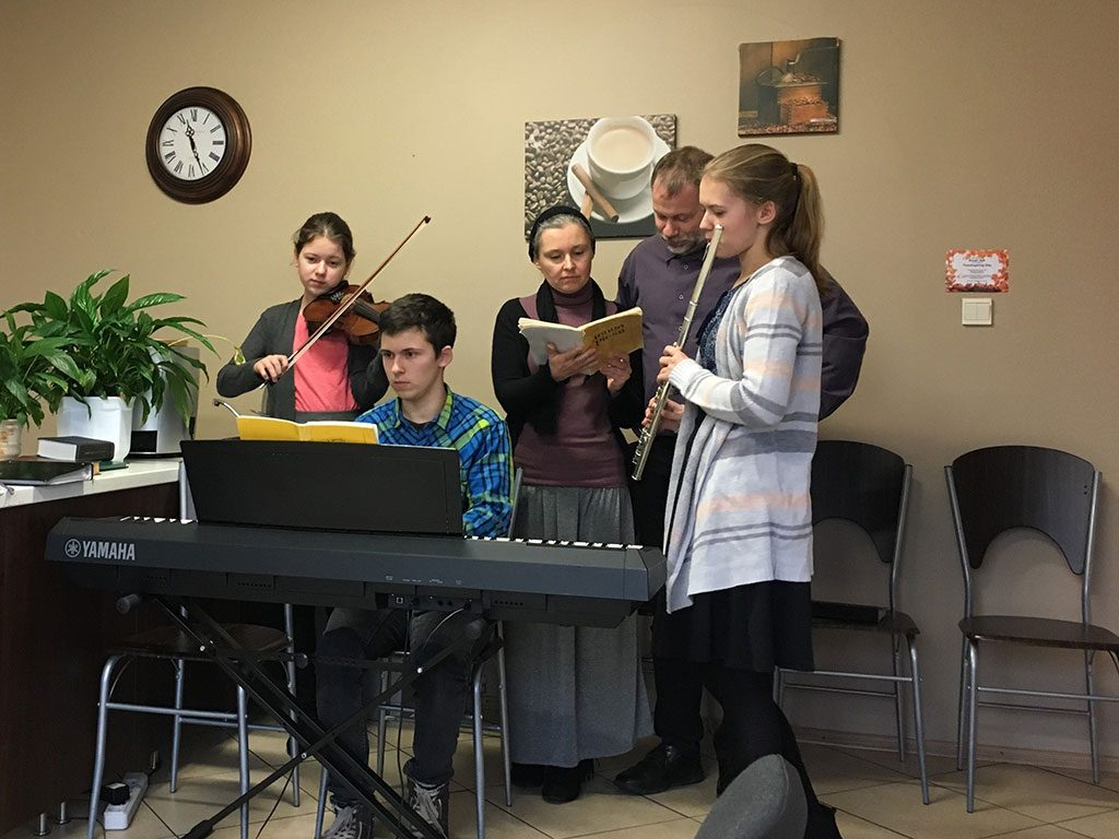 Daniel Faferko family singing at Agape on Sunday morning