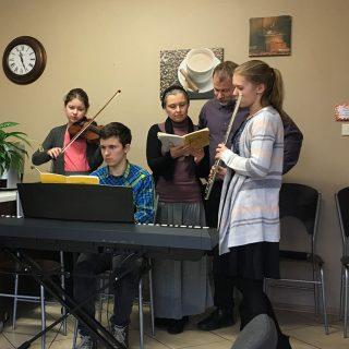 Daniel Faferko family singing at Agape on Sunday morning